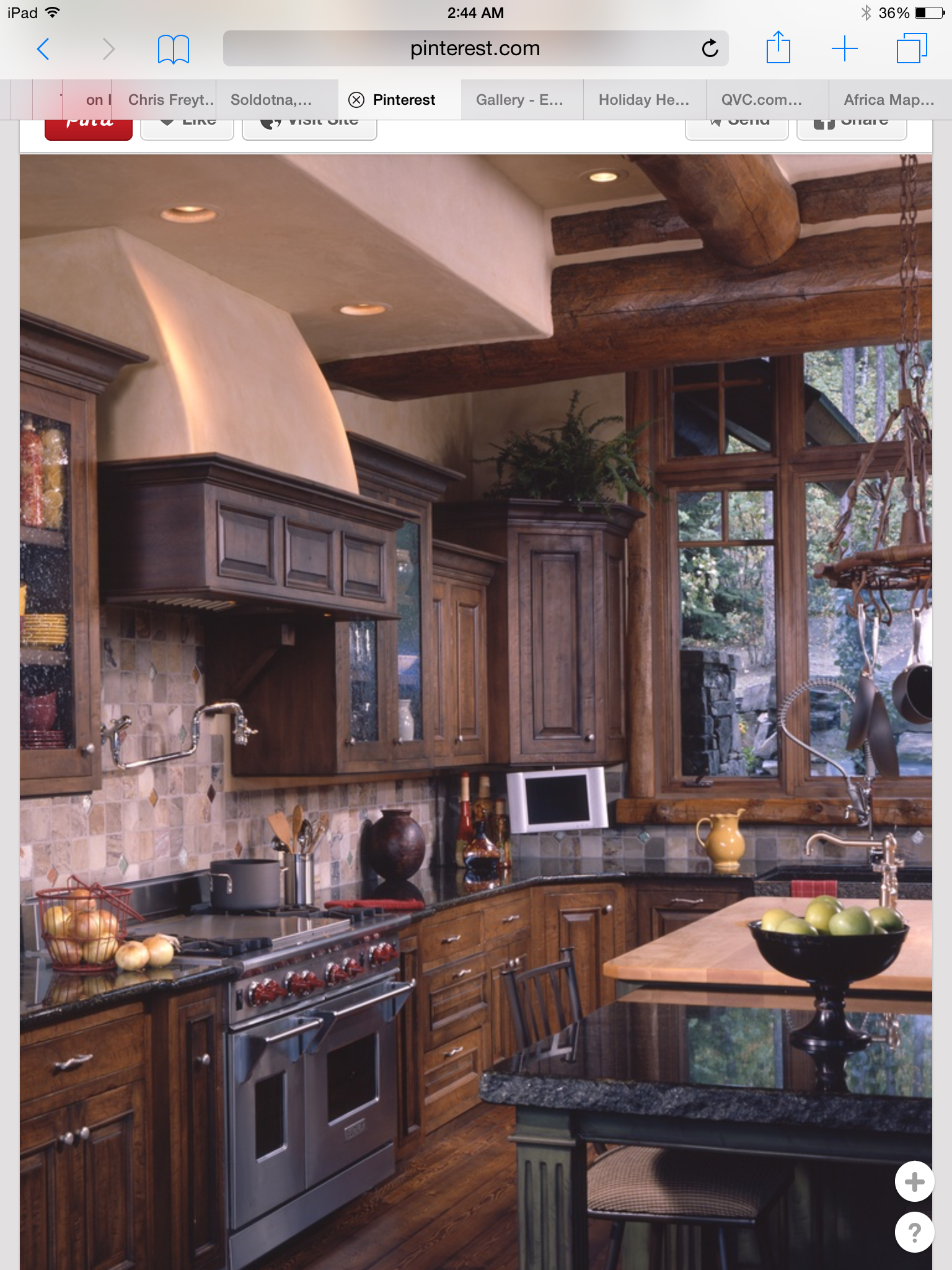 Dark/stained cabinets with black granite countertops ...
