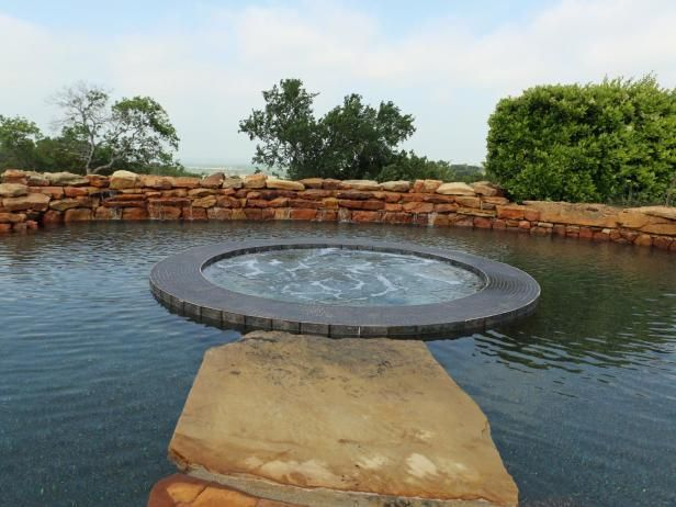At the touch of a button, this wading pool automatically lowers, revealing a hidden spa tub and boulder path.