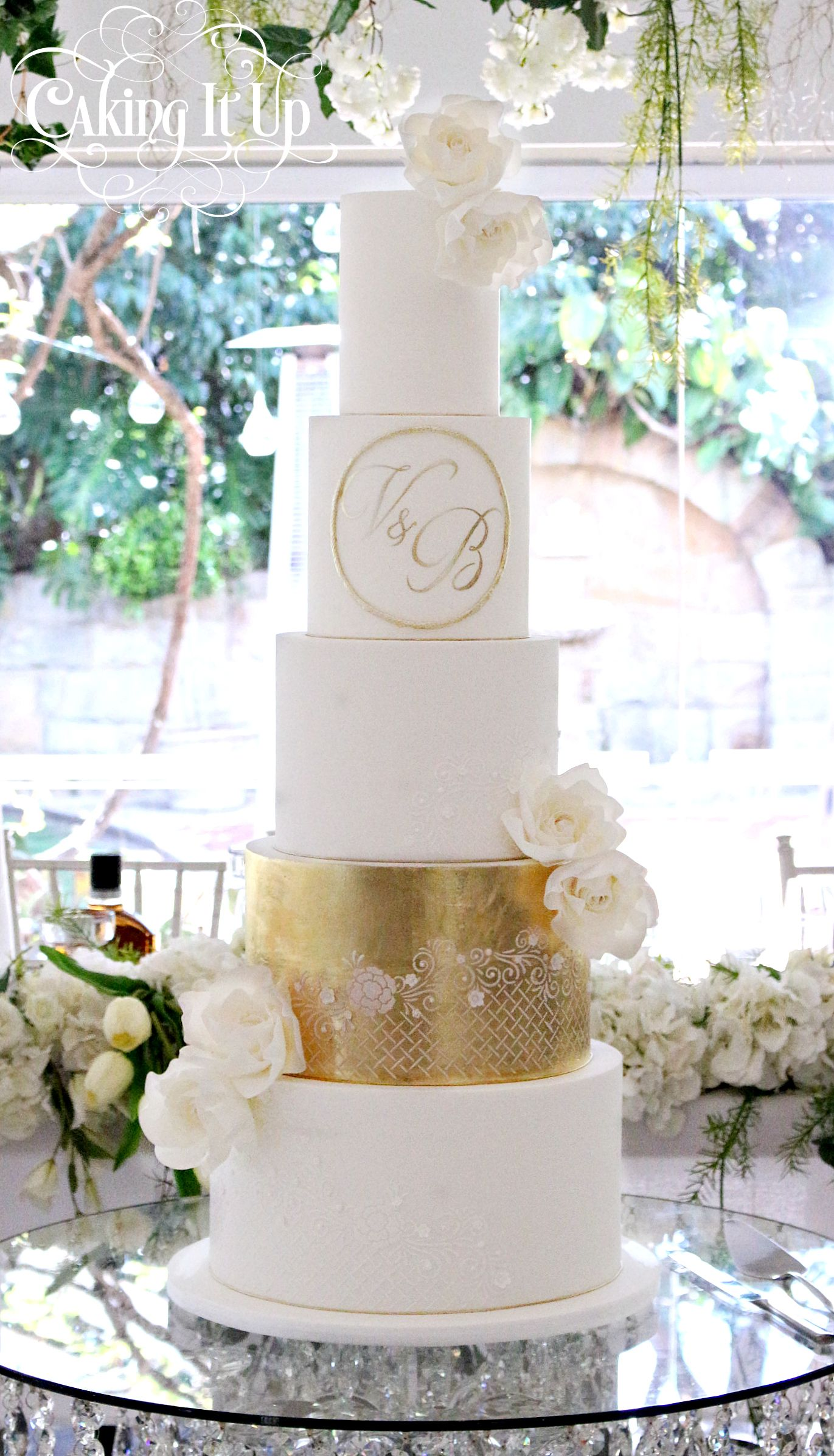 5 tier stunning wedding cake with edible gold leaf tier  stencilling  delicate sugar roses and