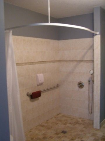 Curbless shower system with ARC Bendy rail curtain unit installed ...
