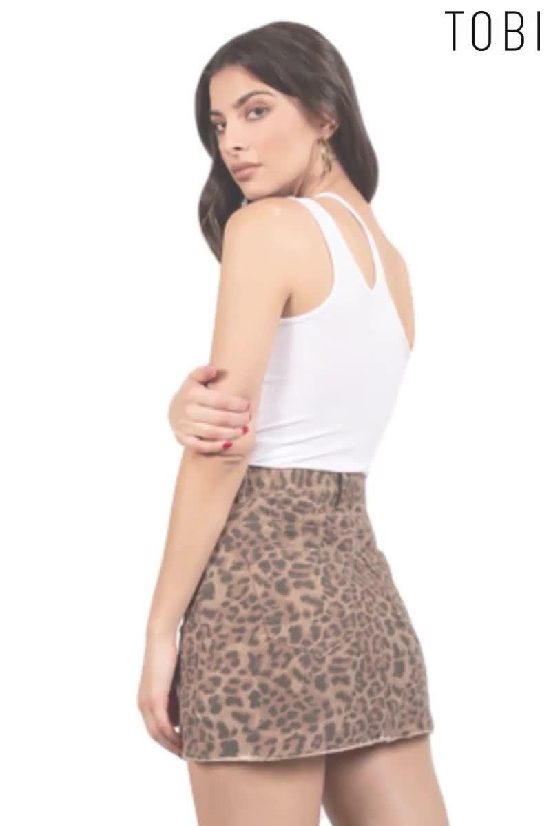 Look sizzling hot in this head-turning leopard print mini skirt with belt loops and pockets. Complete your full outfit with a pair of ankle boots or heels. Shop our wide selection of women's ready to wear casual weekend skirts, bottoms, and trendsetting night out fashion clothing outfits in the latest styles from TOBI online. #shoptobi #womensfashion #skirts #skirtoutfits #bottomsforwomen #casualoutfits #fashiontrends #fashionoutfits