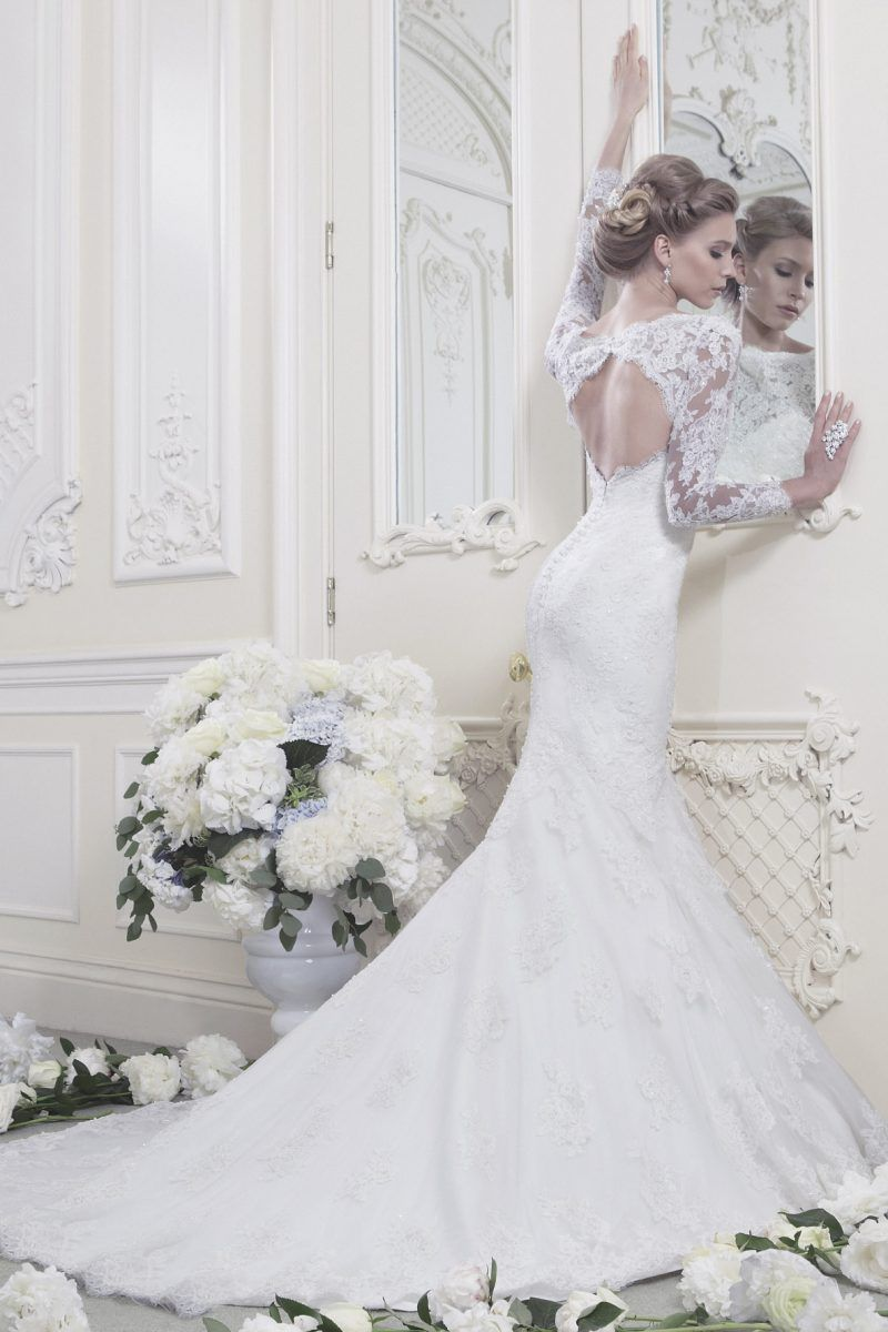 Fitted fishtail gown with beaded lace sheer sleeves and keyhole