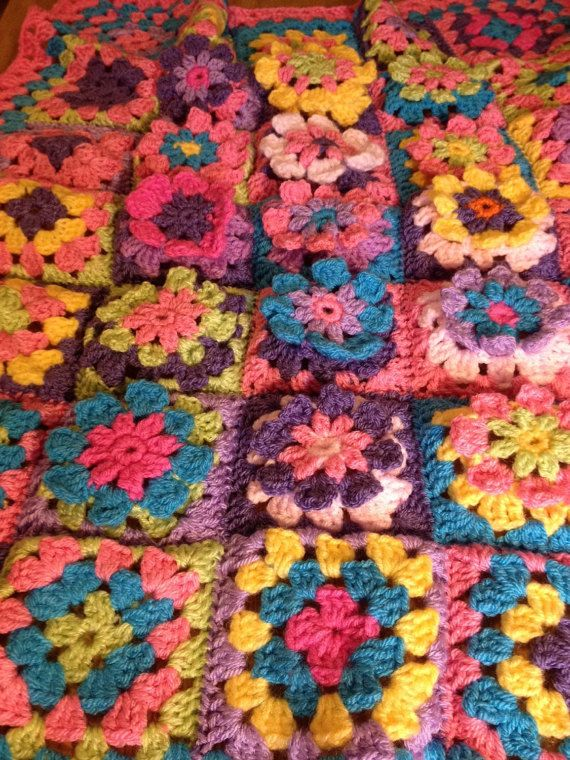 Gorgeous crocheted blanket with 15 flower squares ; all with raised petals (crocheted as part of blanket rather than sewn on for extra safety for little one). These squares are surrounded by a row of brightly coloured squares in same colours followed by a pink and turquoise border. This measures 27.5x21.5 inches (70x55cm) so ideal to be used for car seat, pram and of course to be carried around when this becomes the childs favourite blankie !! Please note this blanket is not lying flat due…