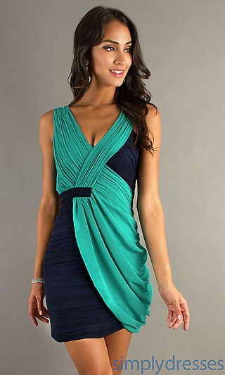 A short v-neck sleeveless dress with softly draped ruching and a ...
