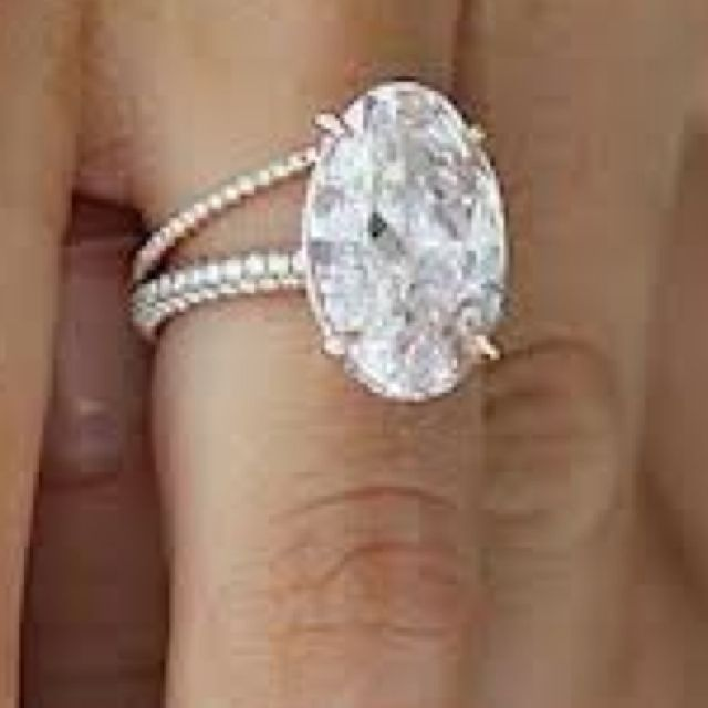I LOVE THIS RING!! Oval diamond with a touch of pink, touch of pink diamond encrusted bands, and rose gold metal. SWOON~~~~~