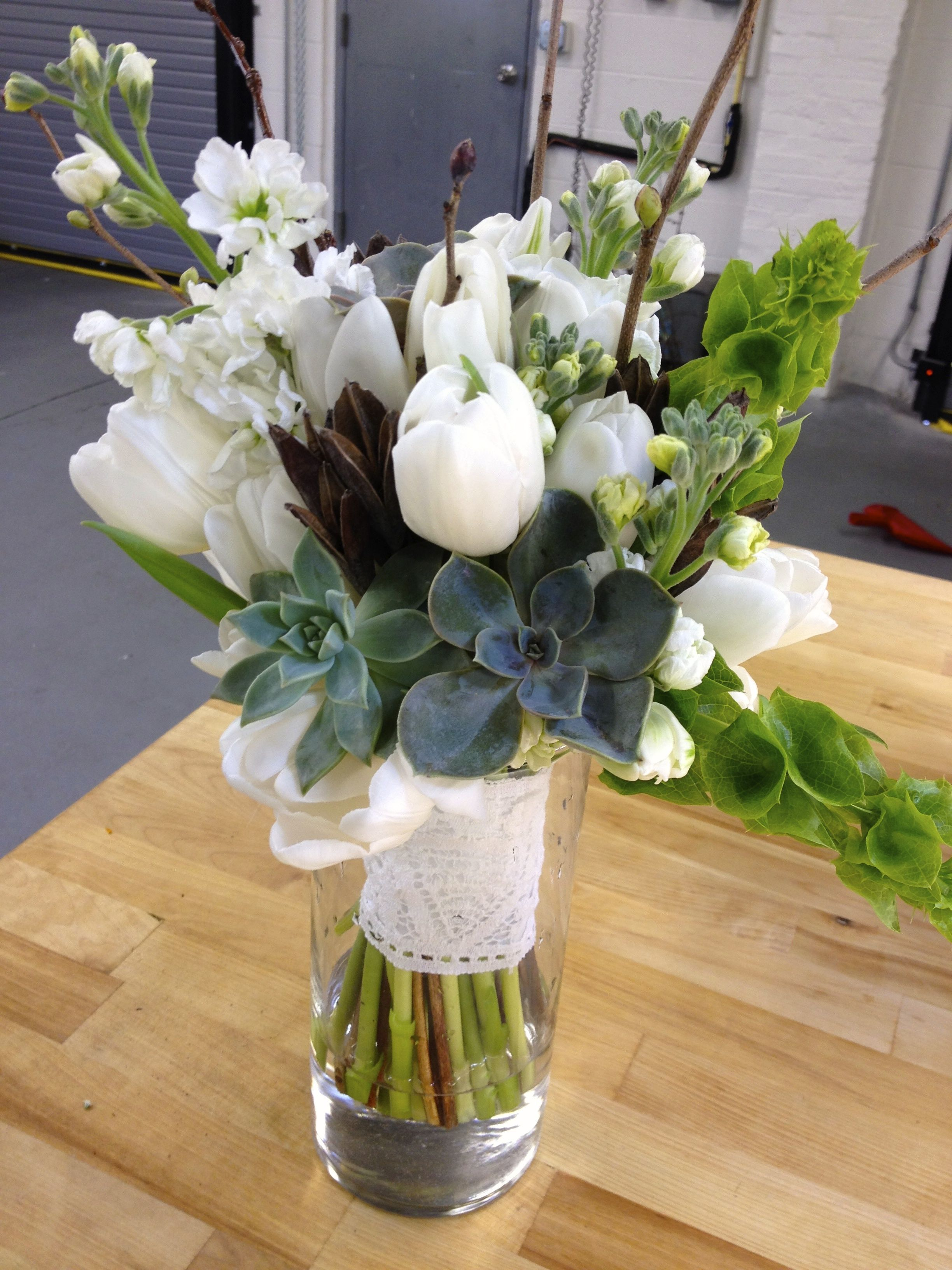 April bouquet with succulents, bells of Ireland, tulips