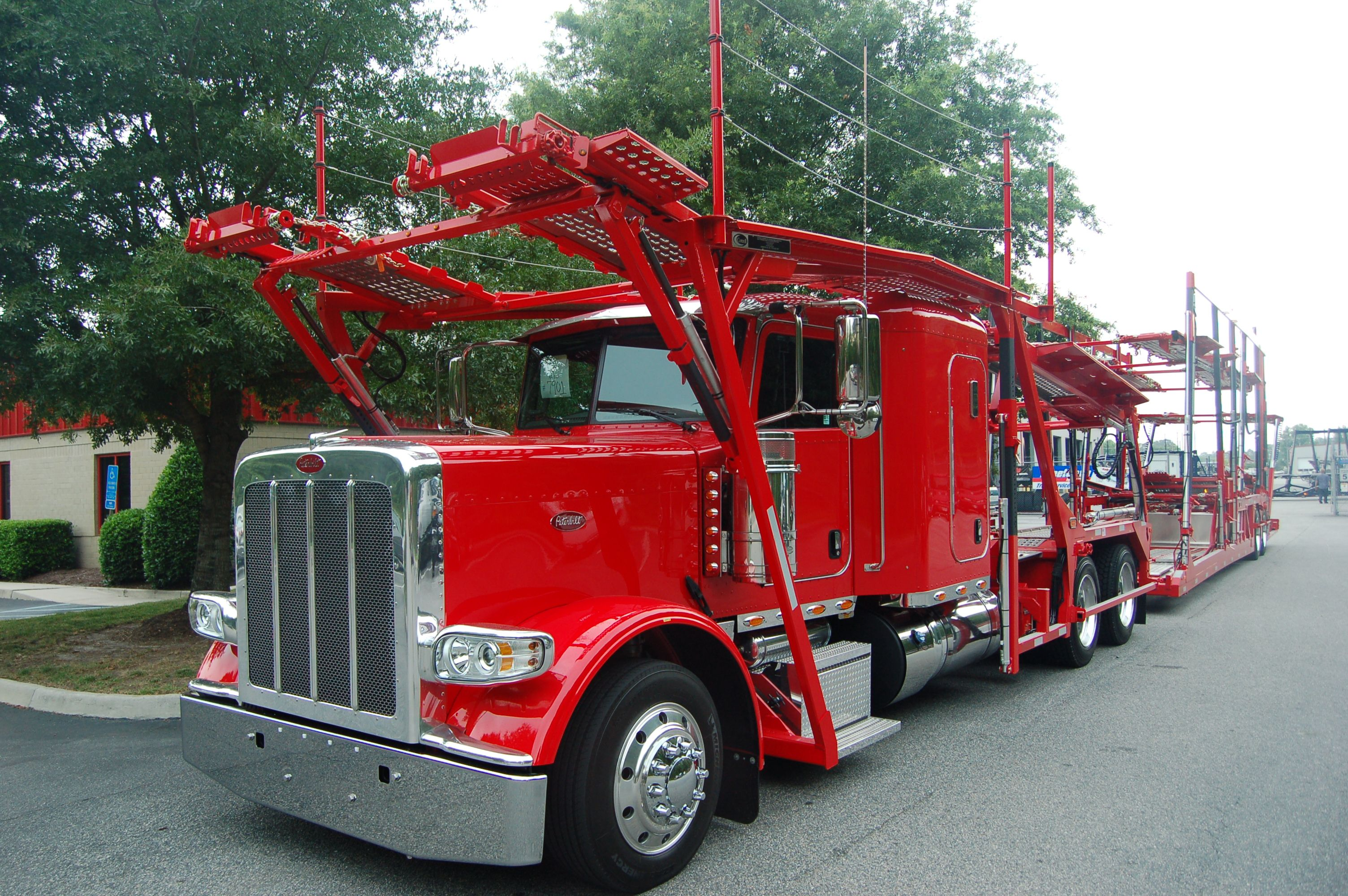 Red Peterbilt Carhauler With Cotrell Headrack And Highrail Trailer