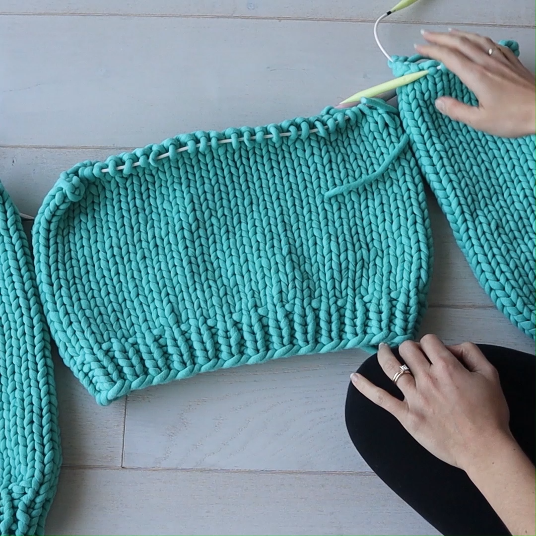 Photo of How to add sleeves when knitting a bottom-up sweater!