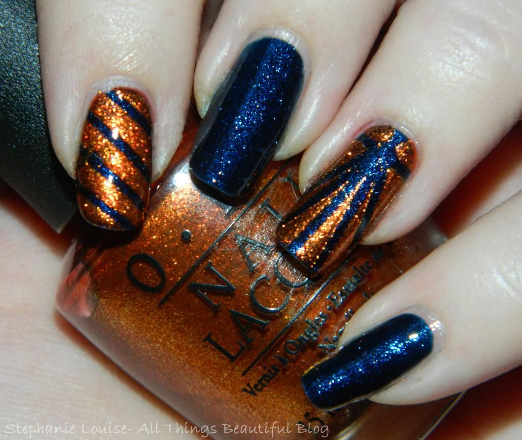OPI Sprung + Color Club Williamsburg Easy Fall Nail Art Combo http://stephanielouiseatb.blogspot.com/2013/11/opi-sprung-color-club-williamsburg-easy.html  #opi #nailart #nails #nailpolish #stripes #metallic #fall #orange #navy #colorclub #easy #nailtape #beauty #style #bbloggers #beautybloggers
