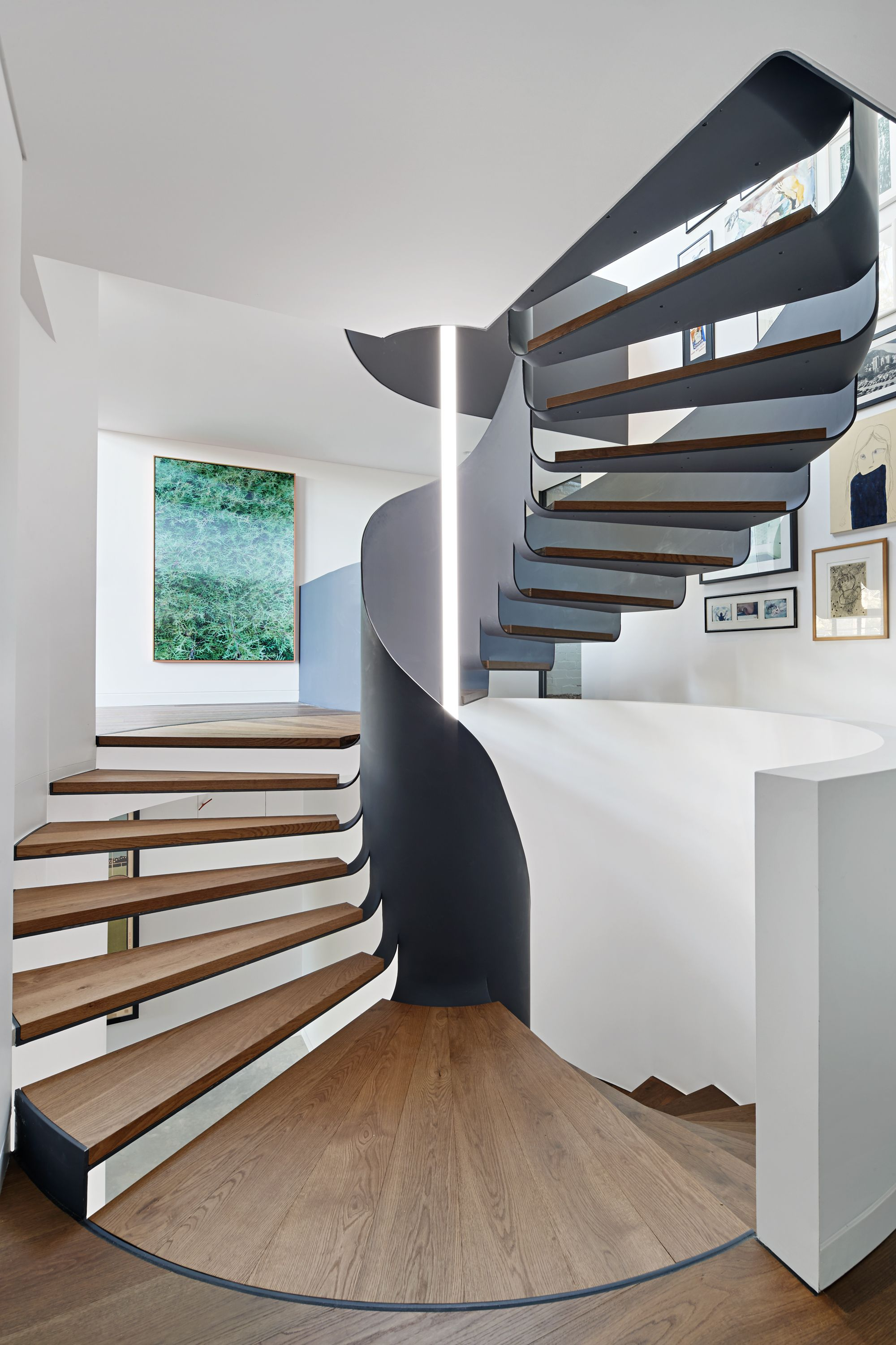 A circular stairway consolidates level changes into a