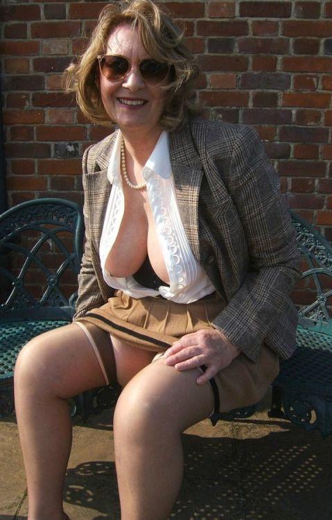 Large older blonde handjob