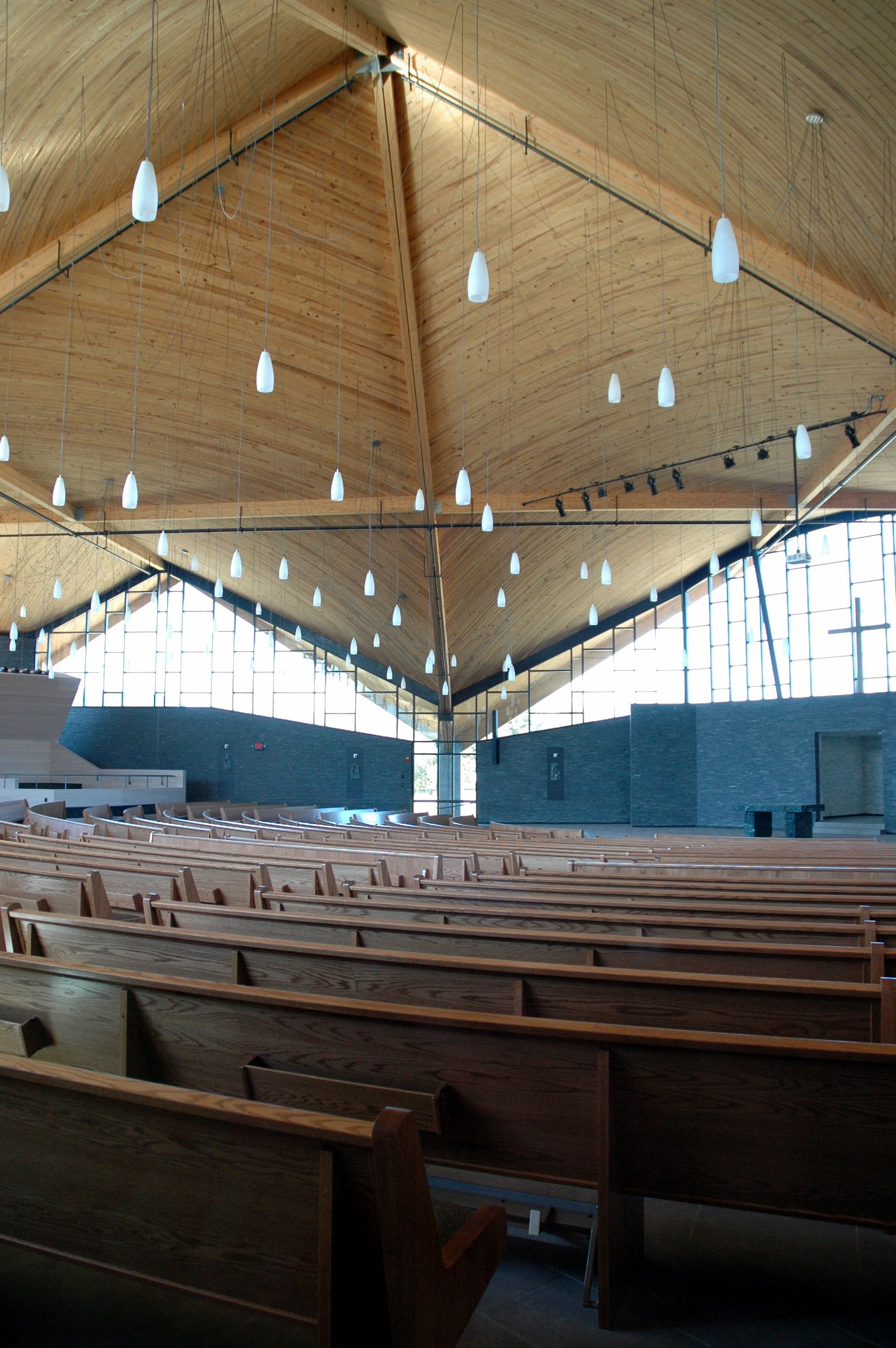 Another detailed shot of the HP roof with glulam beams at St. Alyosius Church in Jackson, NJ. The intersecting directions of the grains of wood create visual interest while keeping the warm glow and natural beauty of the wood.
