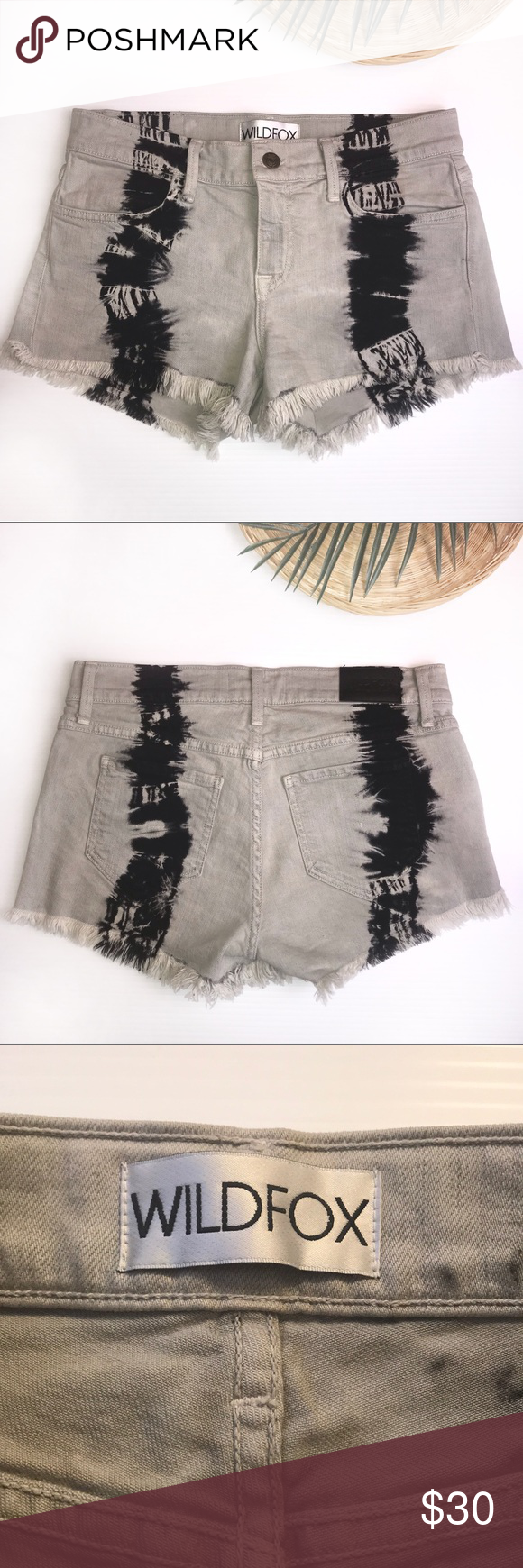 "Wildfox Ruby Tie-Dy Denim Cutoff Shorts Sz 26 Wildfox Ruby Tie-Dye Denim Cutoff Shorts Sz 26  Cutoff frayed bottom hem Gray shorts with black tie-dye streaks  4 pocket detail Stretchy material  98% cotton  2% Spandex   Measurements  Waist 14""  Full length 11"" Inseam 3"" Rise 8""  Comes from a smoke & pet free home! Wildfox Shorts #denimcutoffshorts"