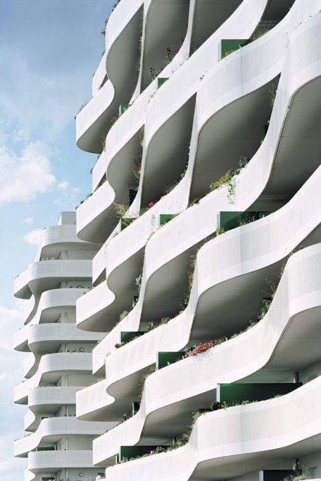 The Curving Balconies Of This Housing Scheme By French Studio Ecdm