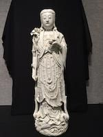 A large blanc de chine figure of Guanyin 19th/early 20th century, two Xu Yunlin seal marks and one Dehua seal mark