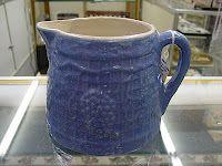 a squat stoneware pitcher