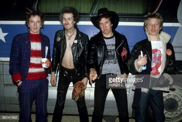 Photo of Steve JONES and SEX PISTOLS and Johnny ROTTEN and Sid VICIOUS, Johnny Rotten (John Lydon), Sid Vicious, Steve Jones & Paul Cook, posed, group shot, next to the tourbus, on final tour