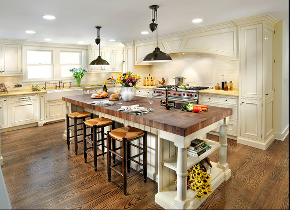 New Kitchen With Island Butcher's Block Island In Kitchen With Creamcolored Cabinets And