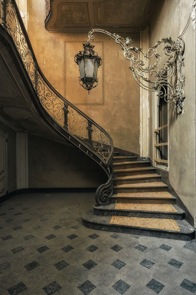 captured in the abandoned Villa Lanterna by Stefan Baumann - escalier interieur de villa
