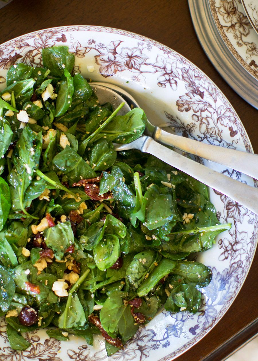 This is easily one my favorite salads. I first had it (I think), about 10  years ago when a friend of mine came over for dinner. She easily threw this  salad together and it did NOT disappoint. It's evolved ever-so-slightly  with the addition of slice almonds. Mediterranean-inspired, it combines