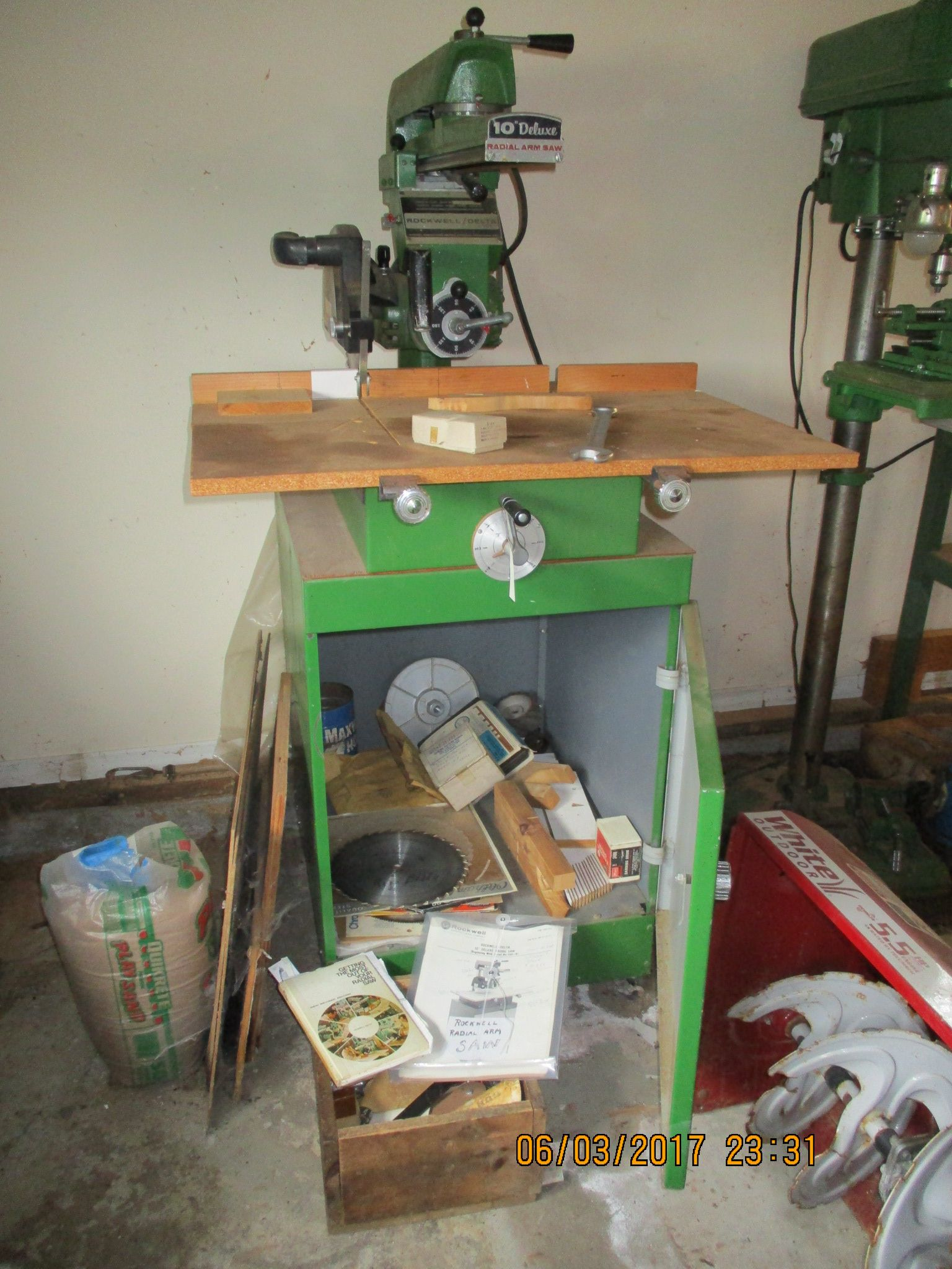 rockwell radial arm saw and i filled the cabinet with extras