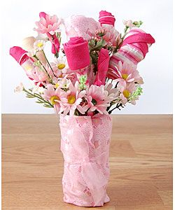 Baby bouquet made to look like flowers when its actuallly clothes unique and fun gift you will ever give a new mom bouquet gift looks like a flower arrangement but is actually beautiful baby clothes wrapped to look like negle Choice Image
