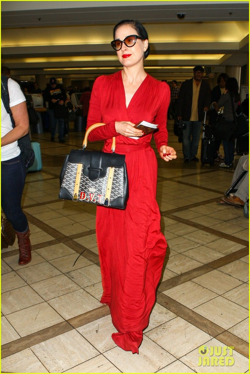 232e45b5bf59 dita von teese announces meet greet 03 Dita Von Teese is the lady in red  while heading into LAX Airport on Tuesday (November 12) in Los Angeles.