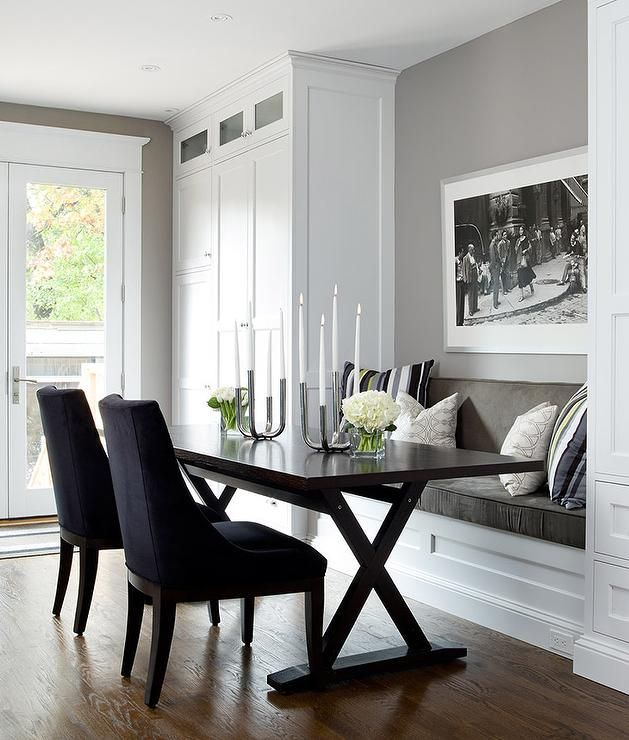 transitional dining nook features a gray built in bench flanked by floor to ceiling cabinets - Built In Kitchen Table
