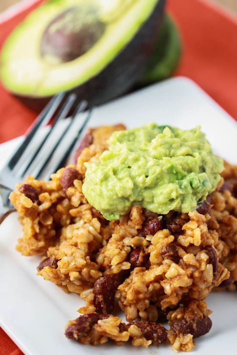 Dinner on the Cheap: Rice & Bean Casserole with Guacamole - one of our favorite go to meals. We add some sautéed veggies (zucchini, peppers, and onions) and serve with sour cream and guac.