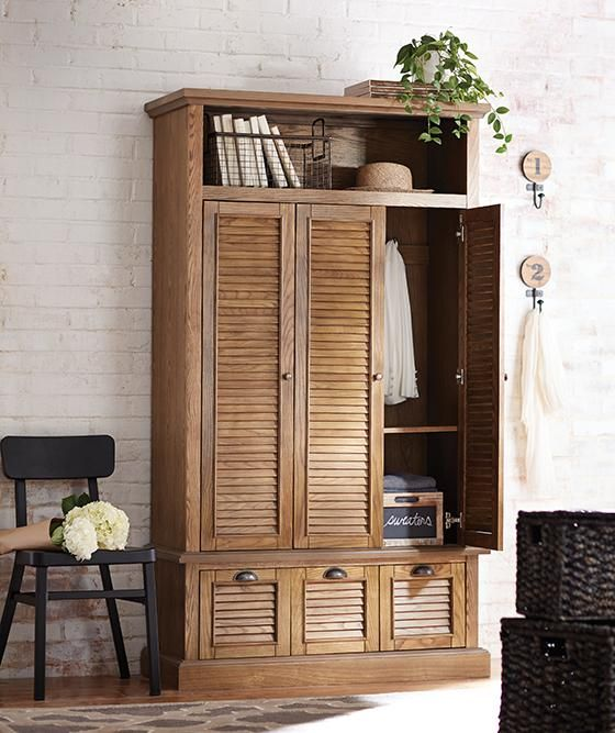 Armoire for coats and linens by the front door since we for Entryway lockers with doors