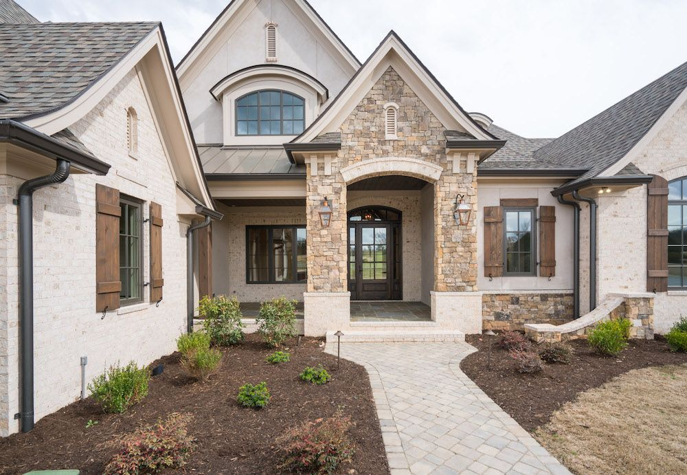 Gorgeous European Style Custom Home Light Brick Stone Accents Dark Shutters And Roof So Prett Brick Exterior House Stone Exterior Houses White Brick Houses