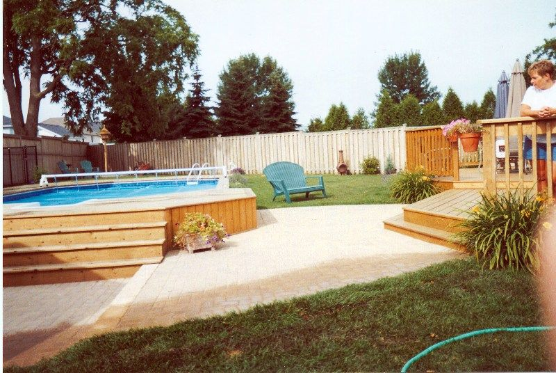 wood raised in ground pools | above ground pool with raised deck