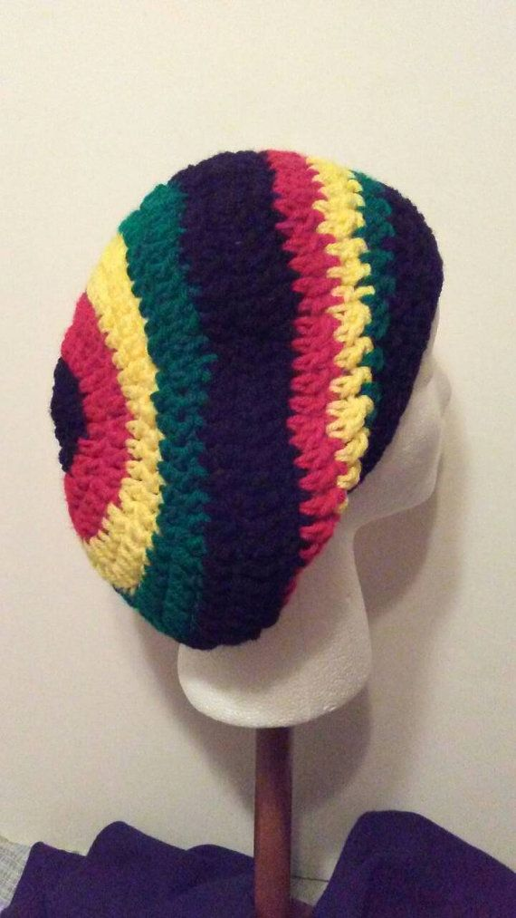 Check out this item in my Etsy shop https://www.etsy.com/listing/478362709/crochet-beret-black-red-yellow-and-green