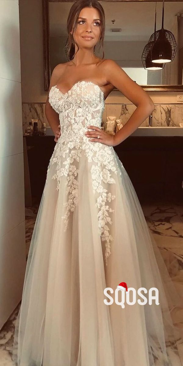 Photo of Illusion Jewel Neck Long Sleeves Sweep Wedding Dress With Appliques TN0039