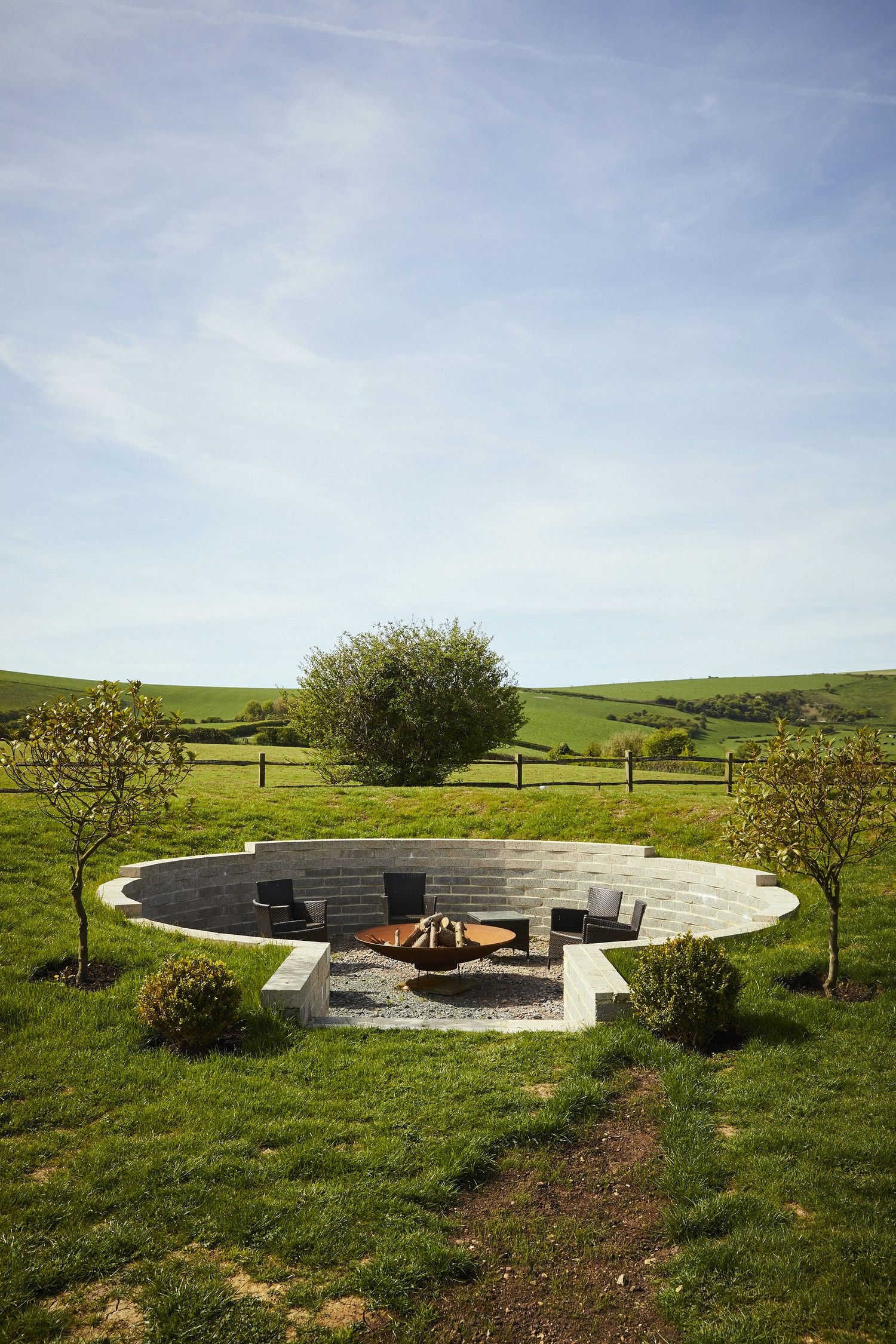 a beautiful shot of a corten steel fire pit embedded in a stunning