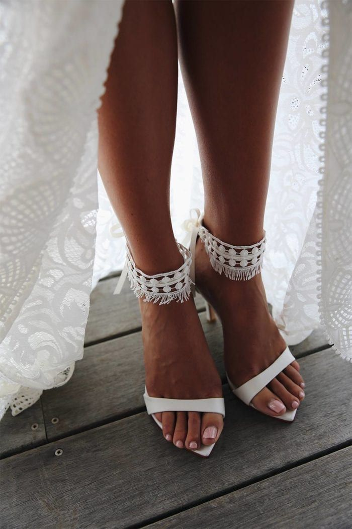 Tribe Anklets   Bridal Shoes & Accessories is part of Boho wedding shoes, Wedding shoes lace, Wedding shoes heels, Beach wedding shoes, Bohemian wedding shoes, Bridal wedding shoes - Effortless and chic, the lace Tribe anklets were designed to be worn with our iconic leather Dosa heels to create your own statement heel  Shop online now!