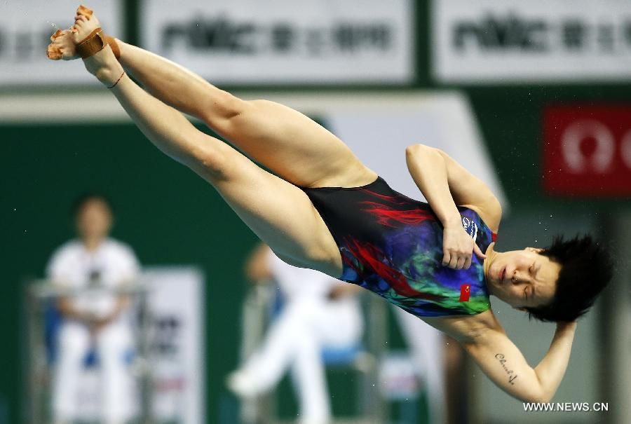 Shi Tingmao of China competes during Women's 3m Springboard final on day 2 of FINA/NVC Diving World Series 2015 at National Aquatics Center as known as the Water Cube in Beijing, March 14, 2015. Shi Tingmao claimed the tile with 389.60 points.