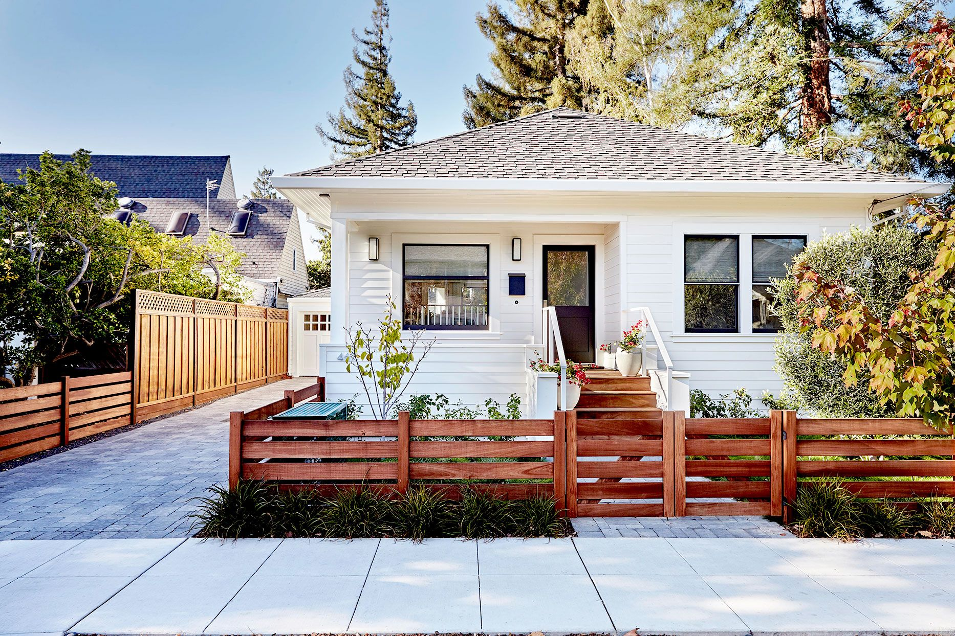 Add Style To Your Yard With These Favorite Fence Ideas Small Bungalow House Exterior Exterior Remodel