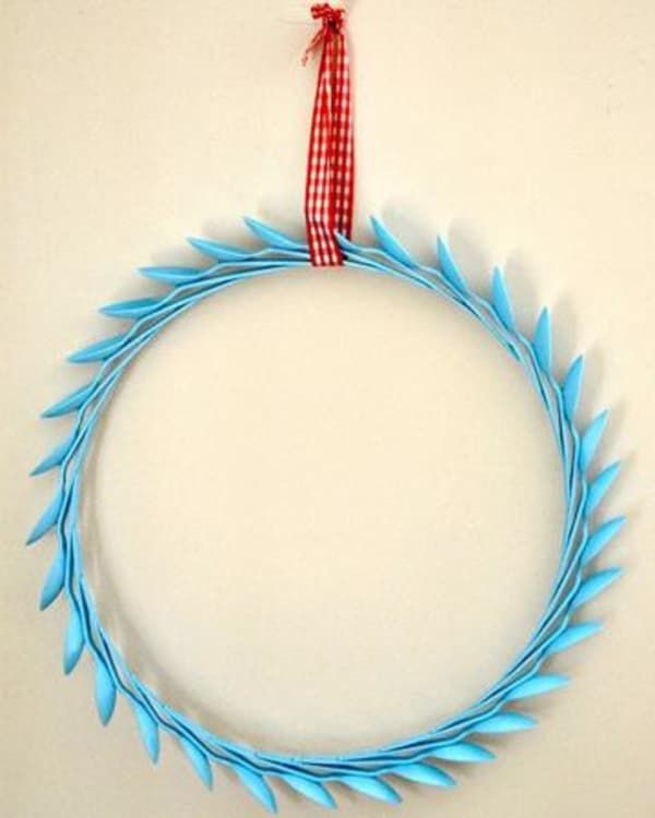 Turn that old flatware and spray paint into a gorgeous statement wreath for your favorite room of the house!