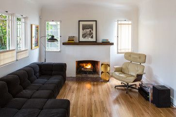 Not this style necessarily, but like the idea of putting a piece of dark wood atop the mantle to give it a little variance, pull in the other wood...