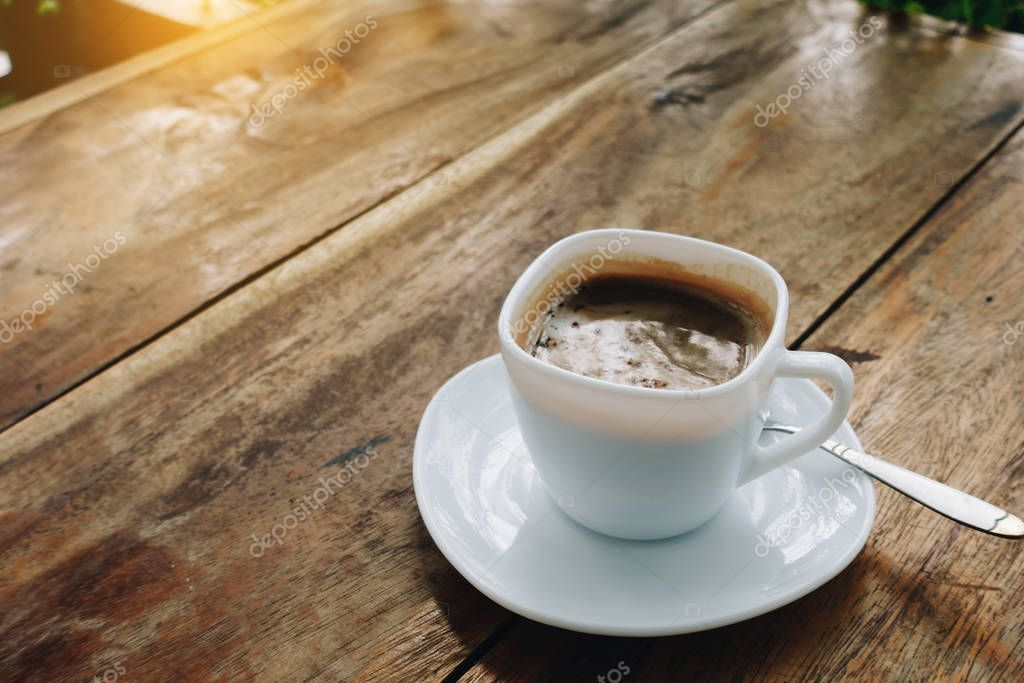 The Ceramic Cup Of Hot Cappuccino Coffee On The Wooden Table In