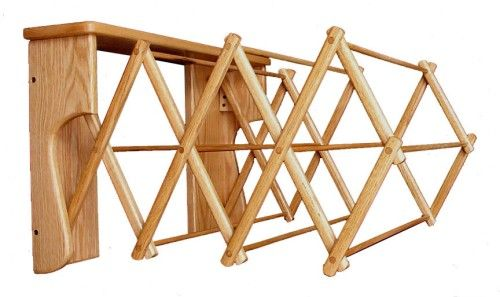Amish Oak Wall Folding Clothes Rack from Cottage Craft Works .com  Order online www.cottagecraftworks.com or by phone 281-638-0050