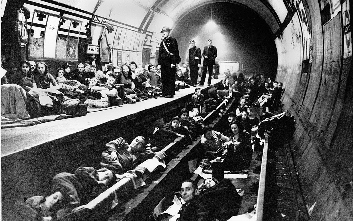 Londoners camp out for the night at the Tube along the platform and train tracks during heavy bombing by the Germans in London, England, on ...
