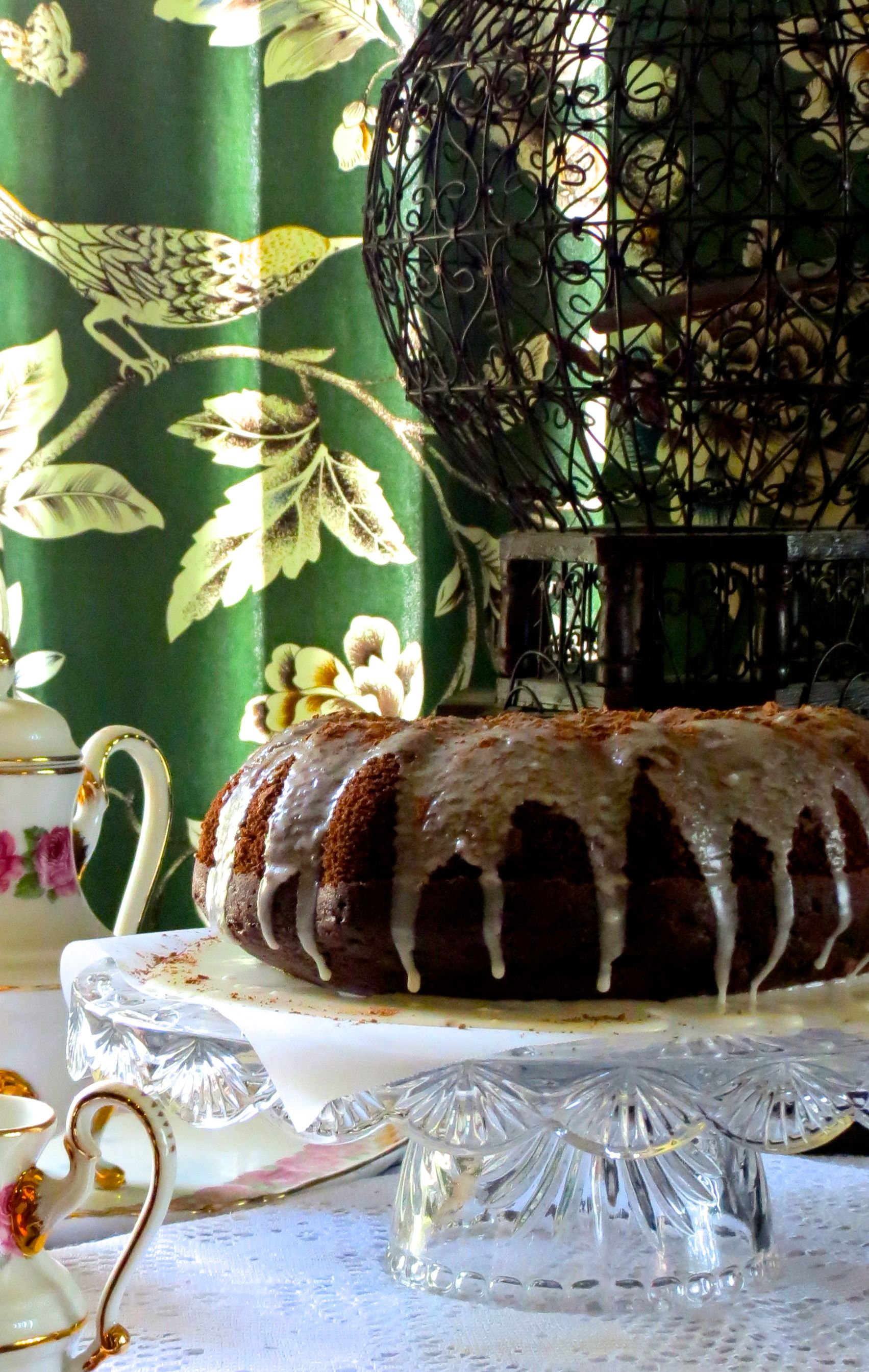 Chocolate Bundt with Vanilla Drizzle and Cocoa Dust