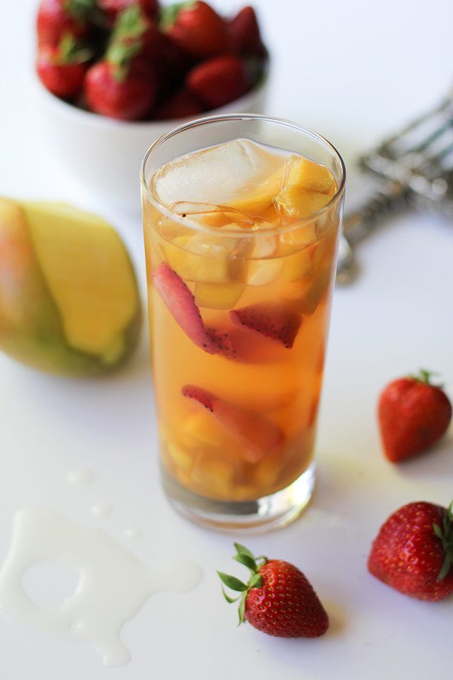 Enjoy tropical white sangria with a variety of fruit.