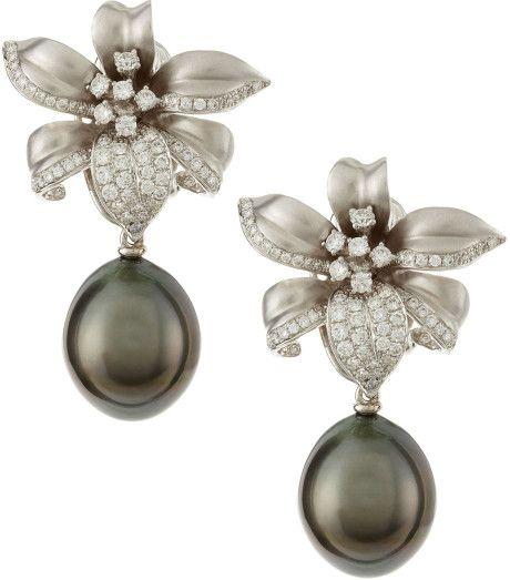 Assael Gray 18k Gold Diamond Flower Tahitian Pearl Earrings Diamonds set in 18-karat white gold 3d flower. Natural color cultured tahitian pearl drops, 14.8-12mm. 1.11 total diamond carat weight.