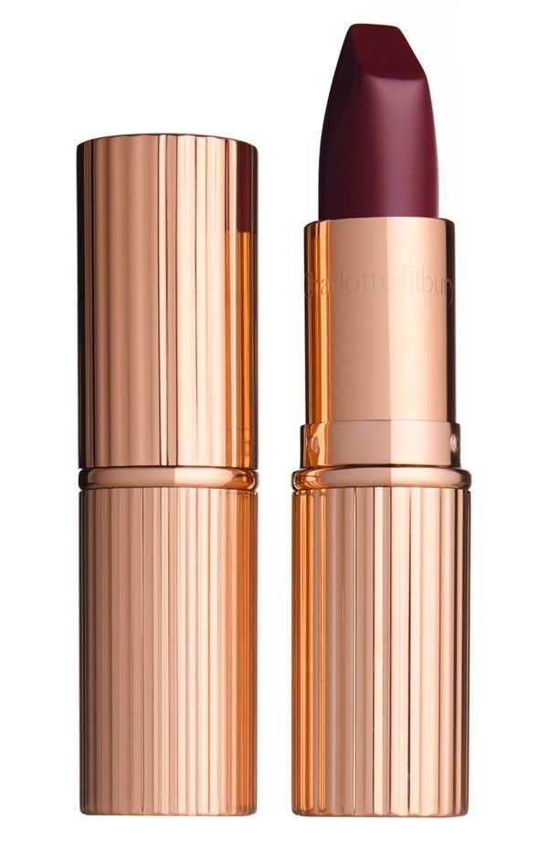 Lend a touch of allure and mystery to the fall makeup look with this deep plum Charlotte Tilbury matte lipstick.