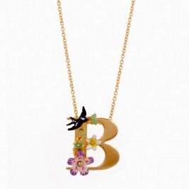 A beautiful and unusual initial necklace by Parisian designers Les Nereides. The letter pendant has been hand finished with painted enamel, Swarovski crystal and shimmering pearls, creating a quirky, detailed piece. £95.00