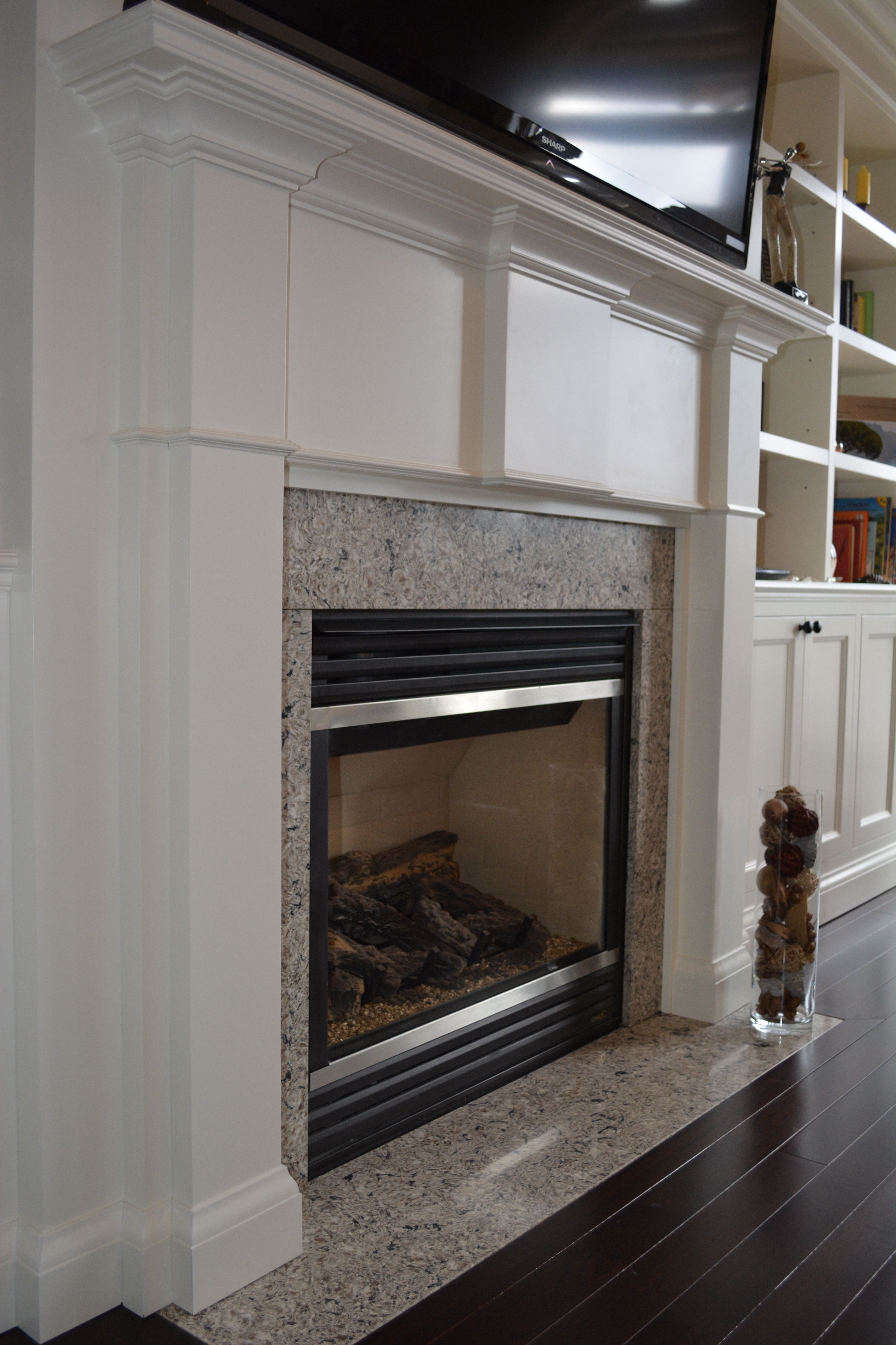 Custom Built In With Bookshelves Storage Behind Closed Cabinet