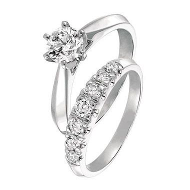 This classic #bridal set in 14k white gold features an #engagement ring in cathedral setting and matching diamond band set with seven graduated round brilliant cut diamonds for a dazzling effect. #wedding  *Enlarged to show beauty of detail
